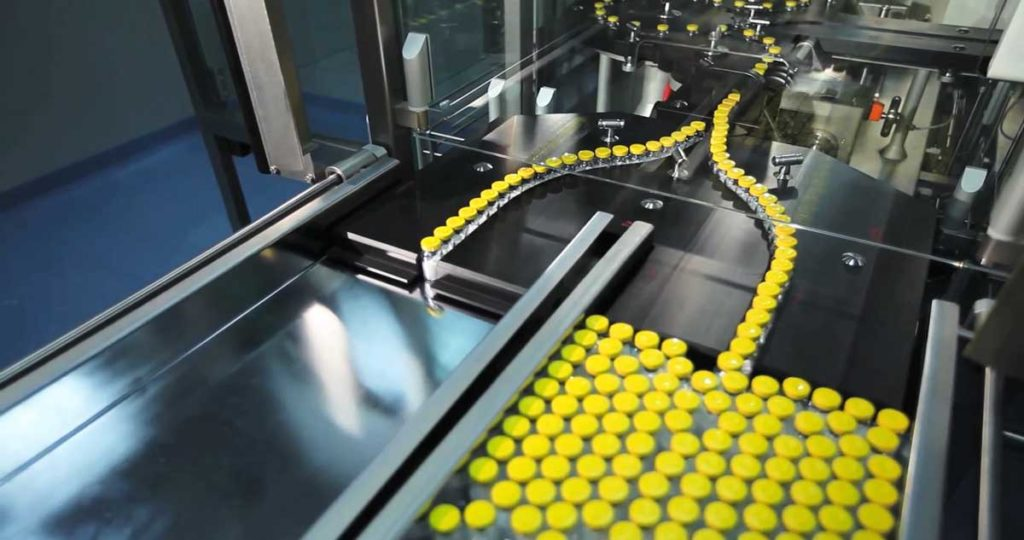 Automated line for marshalling bottles of drugs